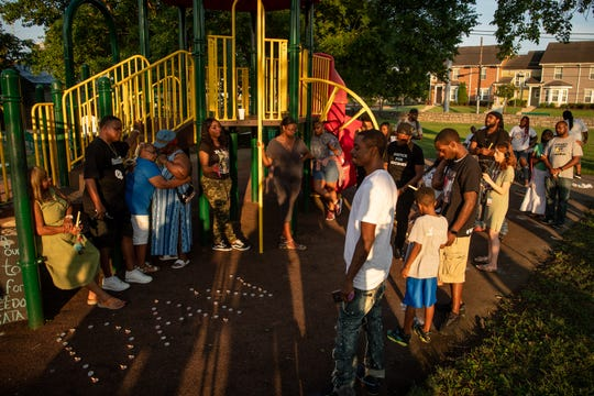 Friends and family gather during a candlelight vigil on the anniversary of the fatal shooting of Daniel Hambrick at Watkins Park in Nashville on Friday.