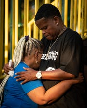 Vickie Hambrick, mother of Daniel Hambrick, is comforted by her brother, Sam Hambrick Jr., during a candlelight vigil on the anniversary of the fatal shooting of Daniel Hambrick on Friday.