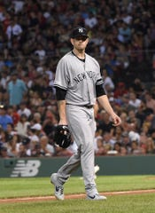 Jul 26, 2019; Boston, MA, USA; New York Yankees starting pitcher James Paxton (65) walks off the mound after pitching during the fourth inning against the Boston Red Sox at Fenway Park.