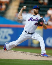 Jul 26, 2019; New York City, NY, USA;New York Mets starting pitcher Zack Wheeler (45) pitches in the first inning against the Pittsburgh Pirates in the first inning at Citi Field.