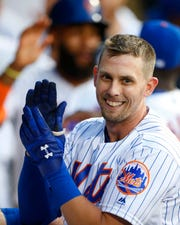 Jul 26, 2019; New York City, NY, USA; New York Mets left fielder Jeff McNeil (6) celebrates in the dugout after hitting a home run in the third inning against the Pittsburgh Pirates at Citi Field.