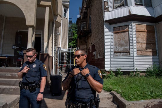 Paterson Police Officers (center) Braulio Montesino and Ibraaheem Yanes respond to a report of a restraining order violation in the 4th Ward on Wednesday, July 24, 2019.
