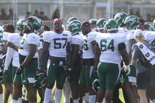 The Jets defense takes a break on day three of training camp for the New York Jets at the Atlantic Health Training Center in Florham Park, NJ on July 27, 2019 and the first day for fans to come and see the Jets practice.