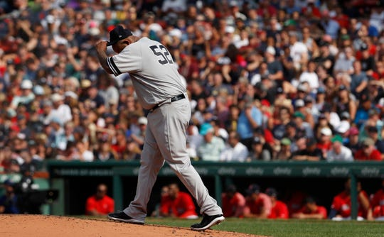Jul 27, 2019; Boston, MA, USA; New York Yankees starting pitcher CC Sabathia (52) reacts on the mound in the second inning against the Boston Red Sox at Fenway Park.