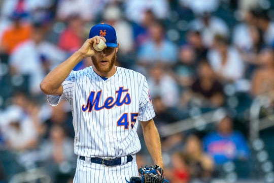 New York Mets starting pitcher Zack Wheeler (45) prepares to pitch during the second inning of a game against the Pittsburgh Pirates, Friday, July 26, 2019, in New York.