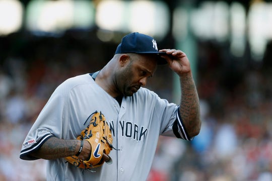 Jul 27, 2019; Boston, MA, USA; New York Yankees starting pitcher CC Sabathia (52) tips his hat to the crowd as he is taken out of the game against the Boston Red Sox in the first inning at Fenway Park.