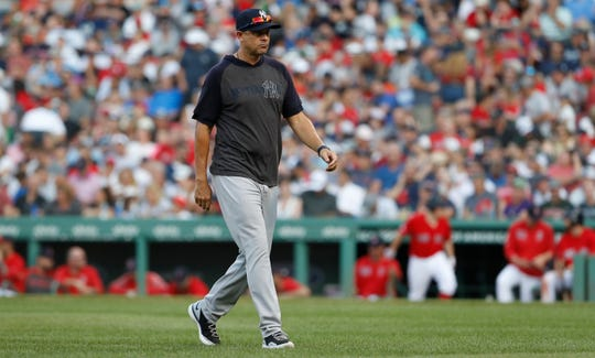 Jul 27, 2019; Boston, MA, USA; New York Yankees manager Aaron Boone (17) makes his way back to the dugout in the seventh inning against the Boston Red Sox at Fenway Park.