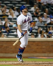 Pete Alonso #20 of the New York Mets watches the flight of his sixth inning home run against the Pittsburgh Pirates at Citi Field on July 26, 2019 in New York City.