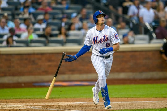 New York Mets' Jeff McNeil drops his bat after hitting a three-run home run, also scoring Amed Rosario and Zack Wheeler, during the third inning of a baseball game against the Pittsburgh Pirates, Friday, July 26, 2019, in New York.
