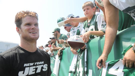 Sam Darnold with fans, along with his team mates, at the end of practice to sign autographs. Jet fans came to see their team on day three of training camp for the New York Jets at the Atlantic Health Training Center in Florham Park, NJ on July 27, 2019 and the first day for fans to come and see the Jets practice.