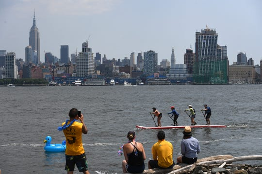 Hudson River Cup and Ohana Festival on the Hudson River in Hoboken on Saturday, July 27, 2019. The Hudson River Cup consists of two races starting at the Hoboken Cove, an 8-mile race to the Statue of Liberty and back for outrigger canoes and surf skis and a 5-mile race to the Colgate Clock in Jersey City and back for kayaks and stand up paddle boards.