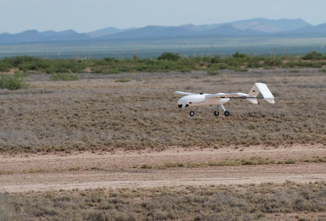 A drone lands during a break in testing of software that would detect manned air craft and making the drone divert course before endangering the manned aircraft. Wednesday July 17, 2019.