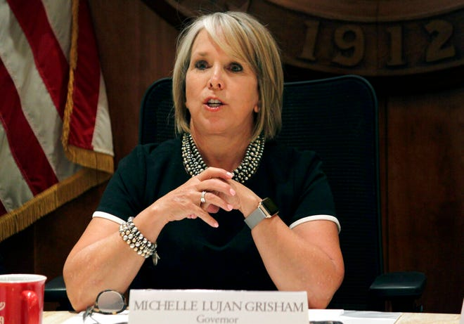 In this July 9, 2019 file photo, New Mexico Gov. Michelle Lujan Grisham provides a progress report on her first six months in office during a news conference in Santa Fe, N.M. New results show less than a third of all New Mexico students are proficient in reading and only about one fifth are proficient in math. The results come days after Lujan Grisham fired Public Education Secretary Karen Trujillo.