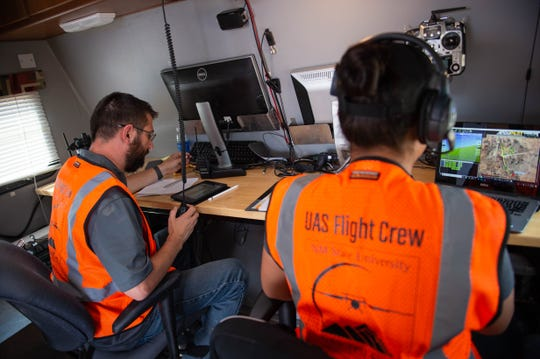 Joe Millette, with NMSU and Cheryl Contreras, Deputy Head of Flight Operations with IRIS watching over flight operation during testing of new software allowing drones to devert their course when appoching a manned aircraft to avoid collisions, Wednesday July 17, 2019 at the Jornada Range Facility.