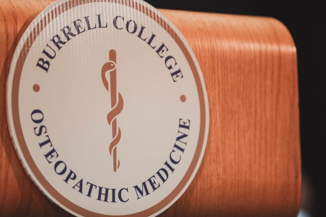 Podium with seal of the Burrell College of Osteopathic Medicine, seen in 2019 file photo.