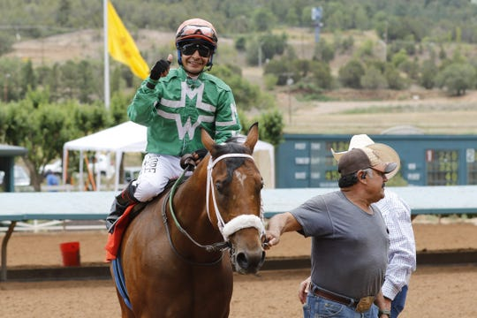 Jockey Luis H Rodriguez gives a thumbs up after his horse Why Buy the Cow won the 1st race of the Ruidoso Downs Zia Fest. In an 870 yard race the horse won with a time of 45.84.