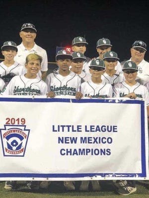 Shorthorn Majors displays its championship banner after beating Eastdale of Albuquerque, 7-2, on Friday to claim the NM State Championship. Shorthorn will travel to Waco, Texas for a chance to play in the Little League World Series.