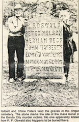 Chloe and Gilbert Peters tended the mass grave marker.