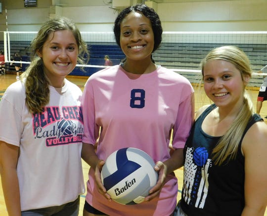 Beau Chene senior volleyball players Raegan Breaux, Armyni Francis and Olivia Badeaux prepare for Thursday's queen-of-the court battle with their teammates.