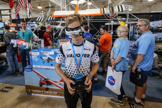 Alex Vanover demonstrates a drone during EAA AirVenture 2019 on Saturday at Wittman Regional Airport in Oshkosh.
