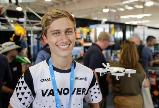 Alex Vanover, 19, of Dallas, demonstrates a drone during EAA AirVenture 2019 on Saturday at Wittman Regional Airport in Oshkosh. The professional drone racer credits attending AirVenture for the past decade with his interest in aviation and drone racing.