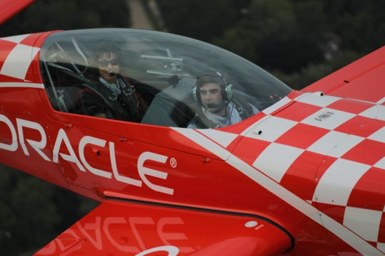 Team Oracle pilot Jessy Panzer and USA TODAY NETWORK-Wisconsin reporter Jeff Bollier on a flight over Oshkosh during AirVenture 2019.