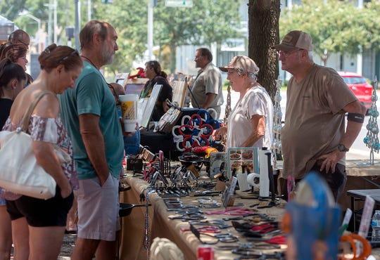 Enjoy art, food, music and more at the Palafox Market.