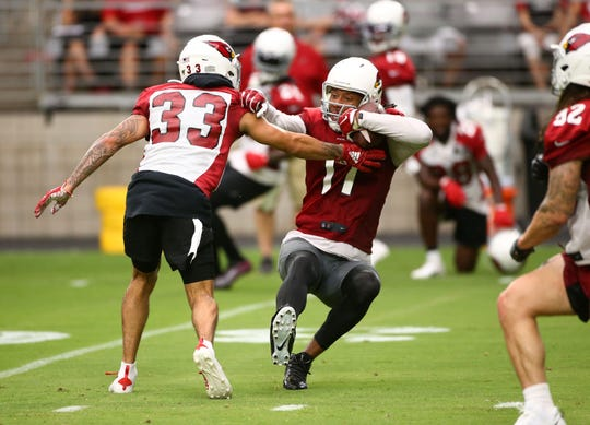 Arizona Cardinals wide receiver Larry Fitzgerald (11) makes a sliding catch during training camp on July 26, 2019 in Glendale, Ariz.