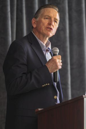 U.S. Rep. Paul Gosar speaks to a crowd of several hundred at the Gila Crossing Community School in Laveen, Ariz., on July 27, 2019.