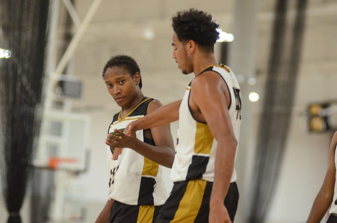 Jul. 26, 2019; Laveen Cesar Chavez guard Tyrone Washington, Jr. and Mpuntain Pointe forward DeAndre Henry shake hands during game at NCAA West Region College Basketball Academy at Grand Canyon University.