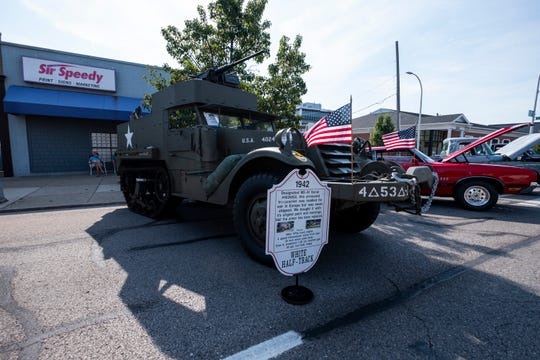 An armored troopcarrier M2-A1 from 1942that was readied for war in Europe but never shipped was also in attendance, parked in front of Sir Speedy on Huron Avenue.