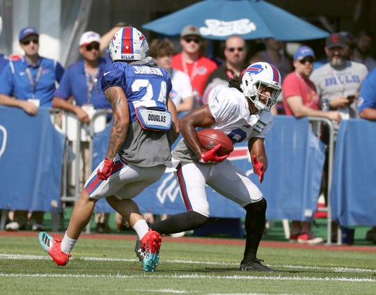 Bills Andre Roberts gets by Taron Johnson during punt drills.