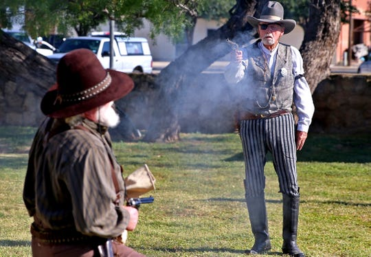 Re-enactors with the Concho Cowboy Company entertain an audience at Fort Concho during the National Cowboy Day celebration Saturday, July 27, 2019.