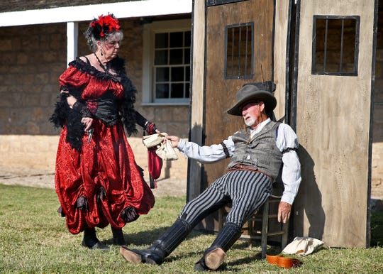 Karen and Jack Smith act out a scene during the National Cowboy Day celebration at Fort Concho on Saturday, July 27, 2019.