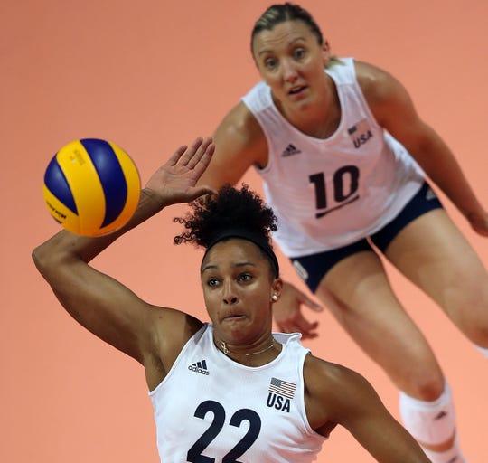 USA's Haleigh Washington returns versus China.