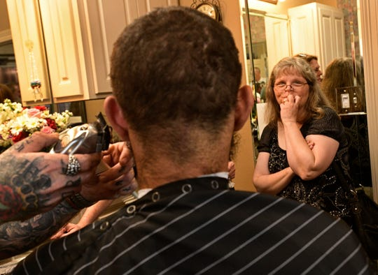 Captain Shreve senior Jared Browning gets his hair removed for Locks To Love at Shreve Towne Barber Shop Friday while his mother, Jennifer Browning, watches.
