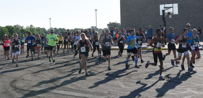 The 10K field begins their race bright and early at 8 a.m. for the Red River Run Saturday, July 27, 2019 at ROCORI High School.