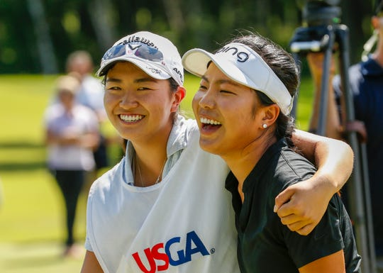 Lei Ye, right, and caddie Rose Zhang celebrate after Le made par on the 36th hole (No. 18) to win the title at the U.S. Girls Junior Championship on Saturday at SentryWorld in Stevens Point.