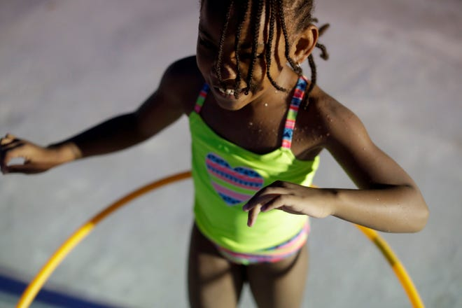 Skye Smith, 7, hula hoops during Splash and Jam at the Walker-Ford Community Center Friday, July 26, 2019.