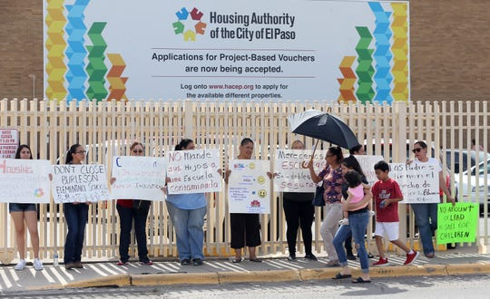 Familias Unidas del Chamizal protest in front of the Housing Authority of the City of El Paso's 10th Annual Backpack Giveaway on Saturday, July 27, 2019. The parents are protesting the closure of  Beall and Burleson elementary schools.