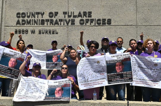 Services Employees International Union 521 members rallied at the steps of the County of Tulare Administrative Offices to protest a proposed 2% wage increase on Friday, July 26.