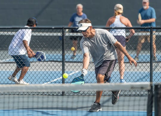 Al Burns plays doubles Pickleball at Plaza Park on Thursday, July 25, 2019.