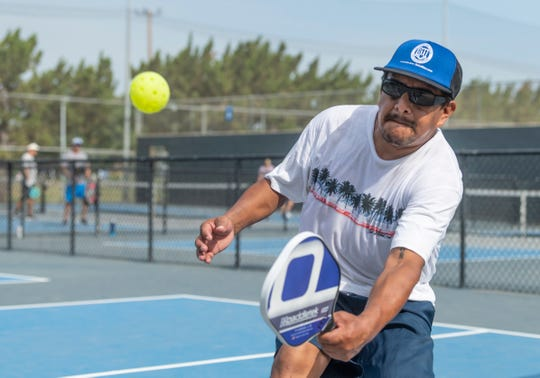 Jorge Reyes plays doubles Pickleball at Plaza Park  on Thursday, July 25, 2019.