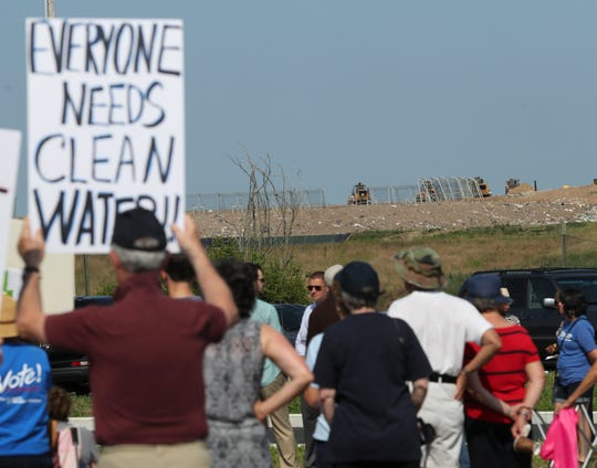 Opponents of increasing the height of the Waste Management landfill in Minquadale protest adjacent to the site at the New Castle County Cpl. Paul J. Sweeney Public Safety Building Saturday morning.