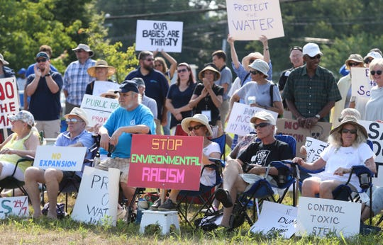 Opponents of increasing the height of the Waste Management-run landfill in Minquadale protest at the New Castle County Cpl. Paul J. Sweeney Public Safety Building in July 2019.