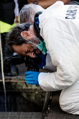 In this picture taken Friday, July 26, 2019 investigators are seen on the scene where an Italian paramilitary policeman was stabbed to death. A young American tourist has confessed Saturday, July 27, 2019, to fatally stabbing an Italian paramilitary policeman who was investigating the theft of a bag and cellphone before dawn Friday, (Angelo Carconi/ANSA via AP)