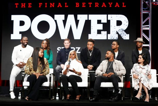 """Mary J. Blige, second from left in the front row, talks about starring in Starz's 'Power' sequel, 'Power Book II: Ghost,"""" as 'Power' cast members and producers, including 50 Cent, far left, listen during a Friday panel at the Television Critics Association summer press tour."""