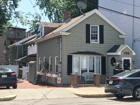 "James ""Whitey"" Bulger buried three bodies at this Boston home. An online listing bills the Cape-style home, which consists of two attached houses, as a ""development opportunity."""