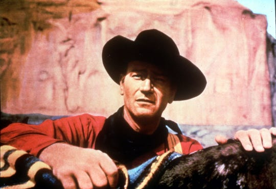 "John Wayne in a scene from Warner Brothers' ""The Searchers."""
