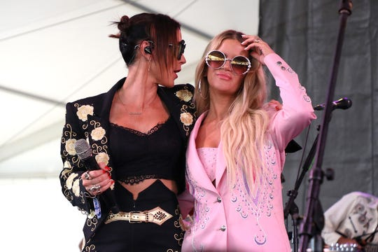 Amanda Shires, left, and Maren Morris of the Highwomen perform during day one of the 2019 Newport Folk Festival at Fort Adams State Park on July 26, 2019 in Newport, Rhode Island.